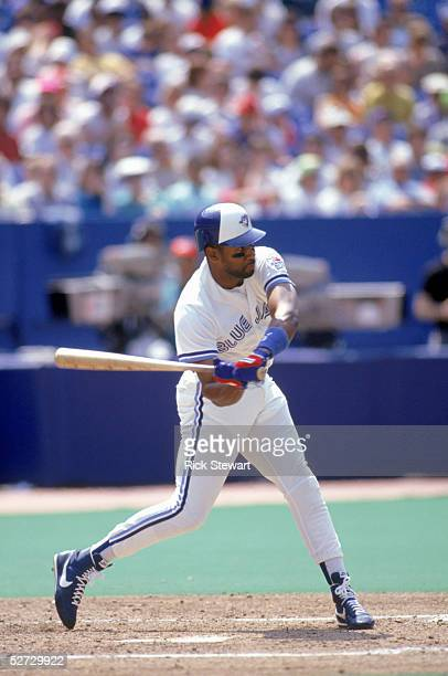 Joe Carter of the Toronto Blue Jays swings at the pitch during the game against the Chicago White Sox at Skydome on May 11 1991 in Toronto Ontario...