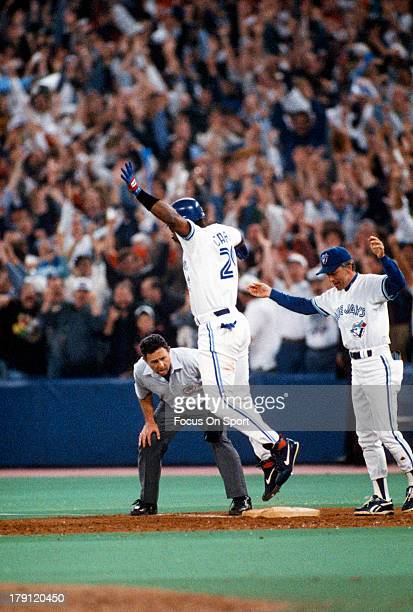 Joe Carter of the Toronto Blue Jays trots around the bases with jubilation after hitting a game winning and World Series winning threerun home run in...