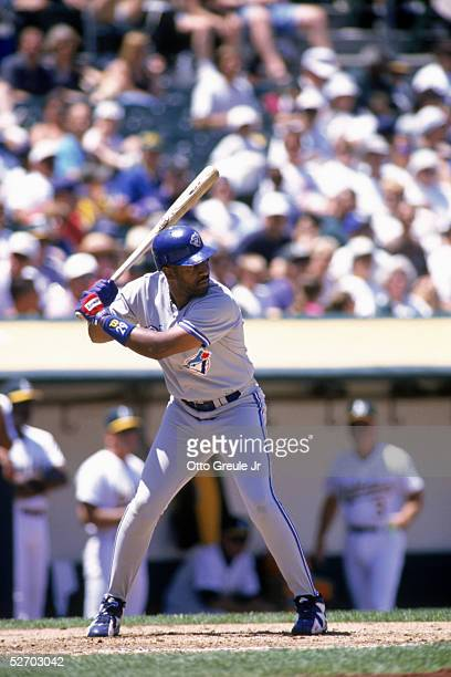 Joe Carter of the Toronto Blue Jays waits for the pitch during the game against the Oakland Athletics at the OaklandAlameda Coliseum on June 22 1996...