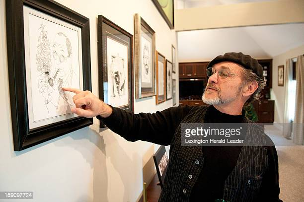 Joe Castillo of Richmond Kentucky looks at one of his drawings depicting the Chronicles of Narnia and it's author CS Lewis December 19 2012 Castillo...