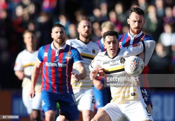 Joe Chalmers of Inverness Caledonian Thistle vies with Stuart Carswell of Dumbarton during the IRNBRU Scottish Challenge Cup Final between Dumbarton...