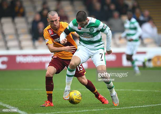 Joe Chalmers of Motherwell vies with Nadir Ciftci of Celtic during the Ladbrokes Scottish Premiership match between Motherwell and Celtic at Fir Park...