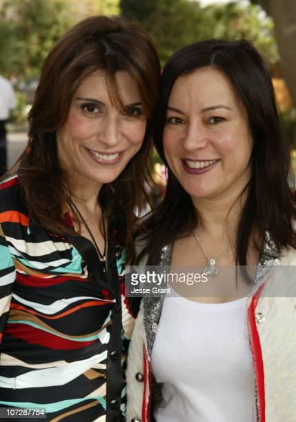 Joe Champa and Jennifer Tilly during Brown Bag Holiday Bash to Benefit PS Arts at Home of Heidi Haddad in Los Angeles California United States