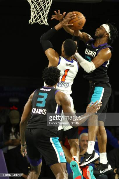 Joe Chealey of the Greensboro Swarm blocks Kenny Wooten of the Westchester Knicks on December 14 2019 at Greensboro Coliseum Complex in Greensboro...