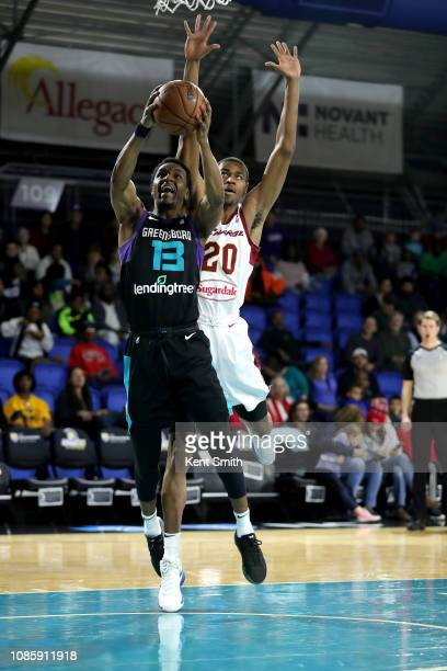 Joe Chealey of the Greensboro Swarm drives to the basket against Phillip Carr of the Canton Charge on January 21 2019 at Greensboro Coliseum...