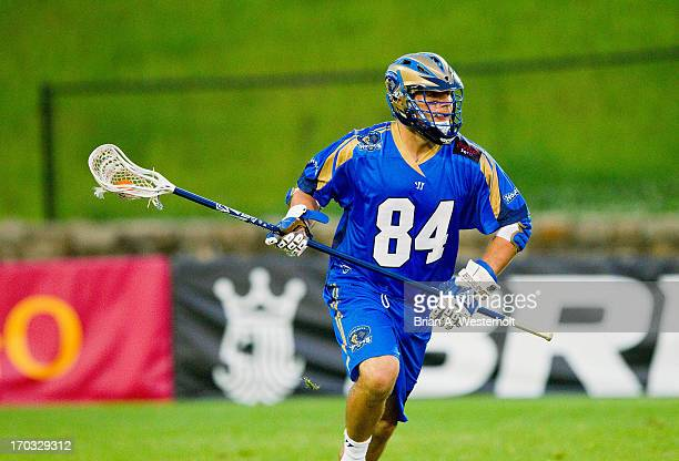 Joe Cinosky of the Charlotte Hounds carries the ball up the field against the Ohio Machine at American Legion Memorial Stadium on June 8 2013 in...