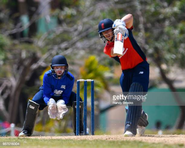 Joe Clarke of North hits a 4 as Ollie Pope of South looks on during the ECB North v South Series match Three at 3Ws Oval on March 23 2018 in...