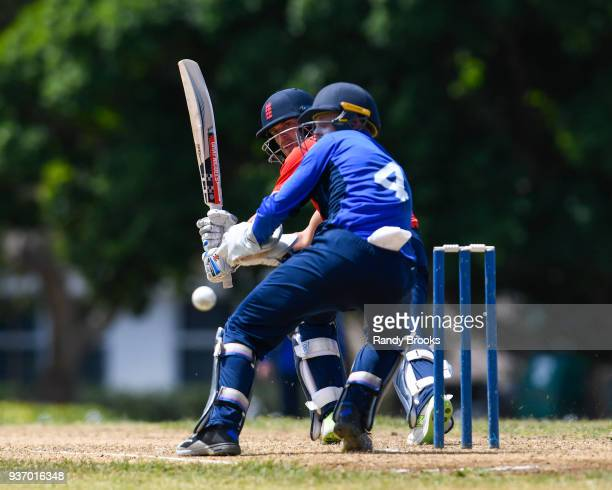 Joe Clarke of North hits past Ollie Pope of South during the ECB North v South Series match Three at 3Ws Oval on March 23 2018 in Bridgetown Barbados