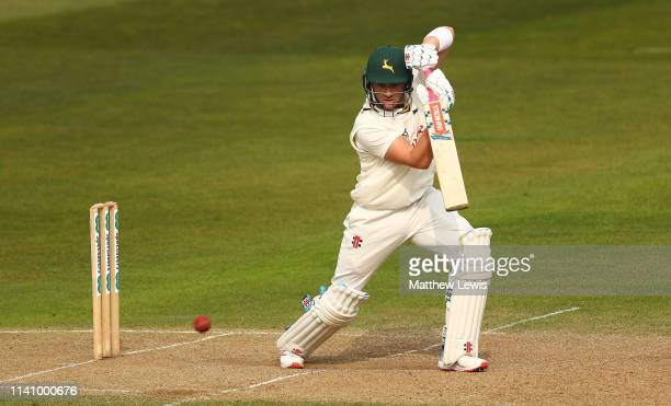 Joe Clarke of Nottinghamshire hits the ball towards the boundary during day three of the Specsavers County Championship Division One match between...