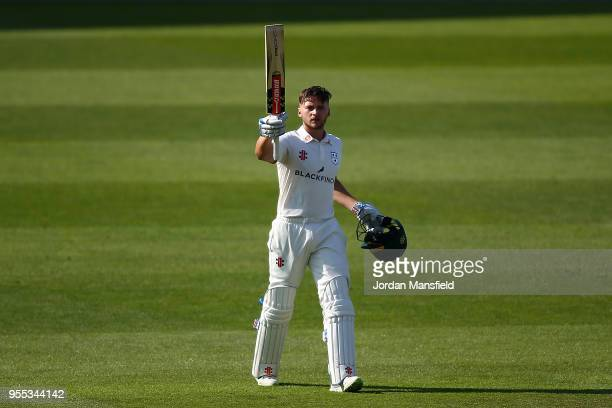 Joe Clarke of Worcestershire celebrates his century during day three of the Specsavers County Championship Division One match between Surrey and...