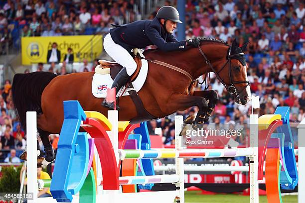 Joe Clee of Great Britain competes on his horse Utamaro d'Ecaussines during the MercedesBenz Prize Team Show Jumping competition on Day 9 of the FEI...