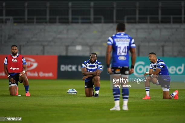 Joe Cokanasiga Ben Obano and Anthony Watson of Bath Rugby takes a knee in support of the Black Lives Matter movement prior to the Gallagher...