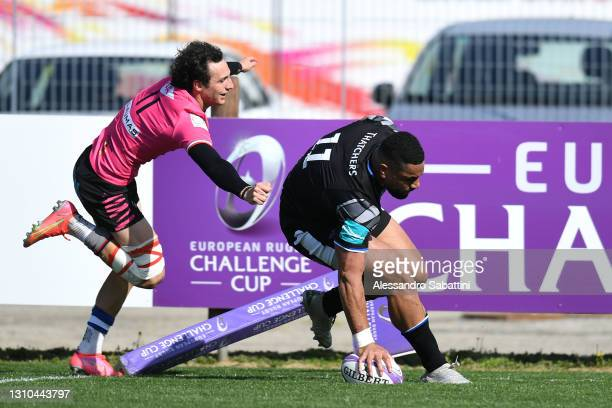 Joe Cokanasiga of Bath beats Giovanni D'Onofrio of Zebre to score their sides first try during the European Rugby Challenge Cup match between Zebre...