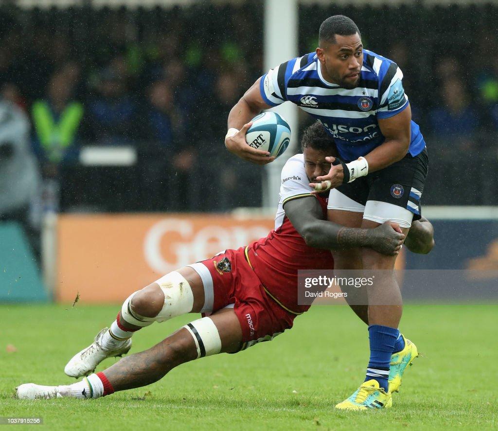 Northampton Saints V Bath Rugby: Joe Cokanasiga Of Bath Is Held By Courtney Lawes During