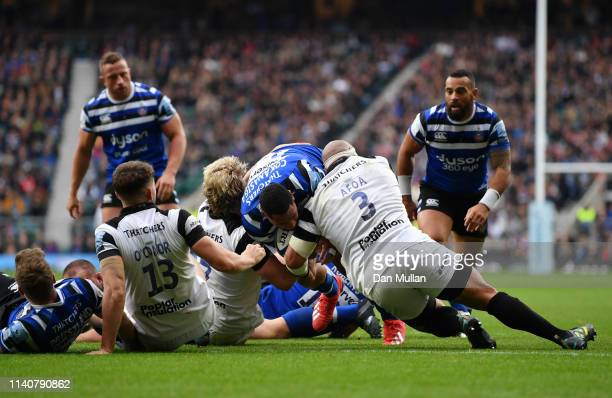 Joe Cokanasiga of Bath Rugby crosses to score his team's third try as John Afoa of Bristol Bears tackles during the Gallagher Premiership Rugby match...