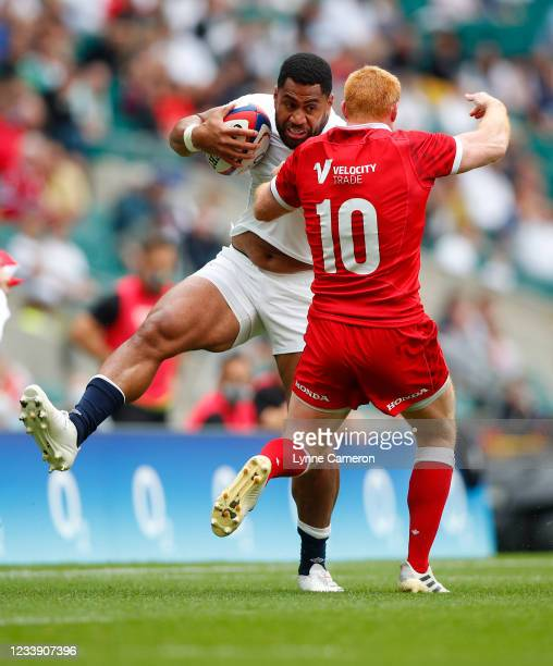 Joe Cokanasiga of England and Peter Nelson of Canada in action during the Summer International Friendly match between England and Canada at...