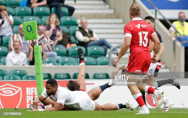 Joe Cokanasiga of England beats Jonah Holmes of Wales to go over to score their side's fifth try during the Summer International Friendly match...