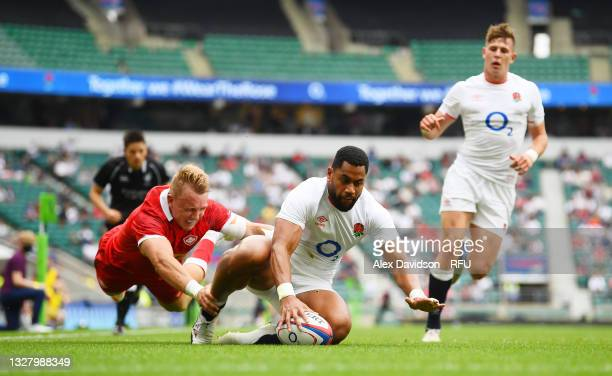 Joe Cokanasiga of England beats Uilisi Halaholo of Wales to go over to score their side's fourth try during the Summer International Friendly match...