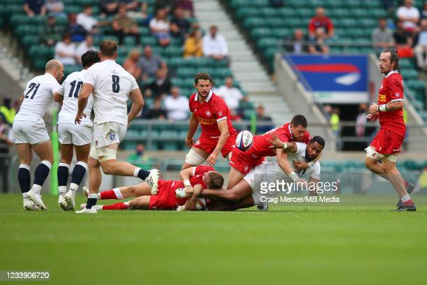 Joe Cokanasiga of England gets an offload away in the tackle during the Summer International Friendly match between England and Canada at Twickenham...