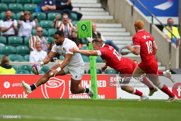 Joe Cokanasiga of England scores his sides fourth try despite the attentions of Ben LeSage of Canada during the Summer International Friendly match...