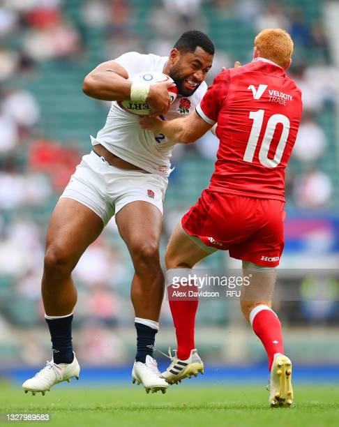 Joe Cokanasiga of England takes on Peter Nelson of Canada during the Summer International Friendly match between England and Canada at Twickenham...