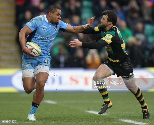 Joe Cokanasiga of London Irish is tackled by Ben Foden during the Aviva Premiership match between Northampton Saints and London Irish at Franklin's...