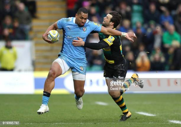 Joe Cokanasiga of London Irish is tackled by Ben Foden of Northampton Saints during the Aviva Premiership match between Northampton Saints and London...