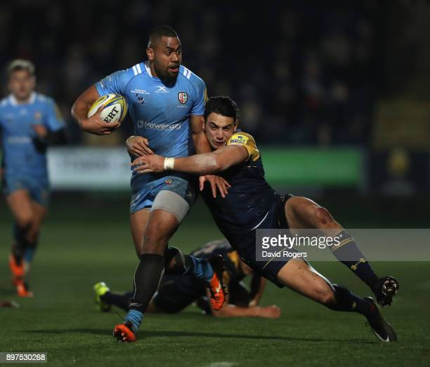 Joe Cokanasiga of London Irish is tackled by Bryce Heem during the Aviva Premiership match between Worcester Warriors and London Irish at Sixways...