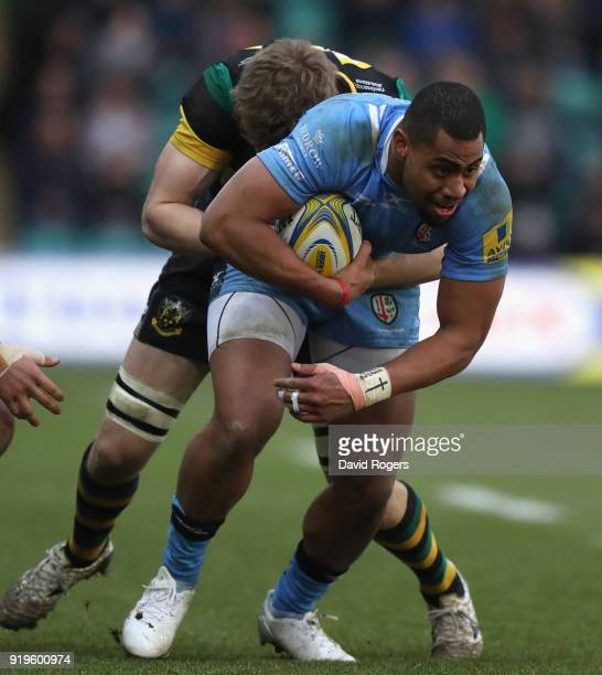 Joe Cokanasiga of London Irish is tackled by Jamie Gibson during the Aviva Premiership match between Northampton Saints and London Irish at...