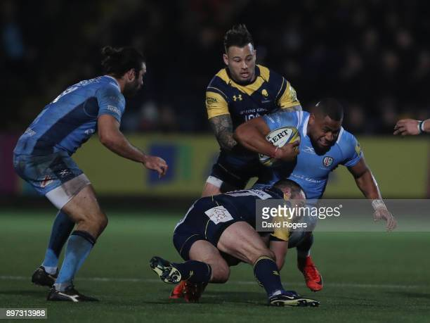 Joe Cokanasiga of London Irish is tackled by Jono Lance and Francois Hougaard during the Aviva Premiership match between Worcester Warriors and...