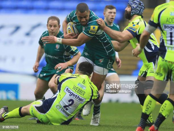 Joe Cokanasiga of London Irish is tackled by Rob Webber of Sale Sharks during the Aviva Premiership match between London Irish and Sale Sharks at...