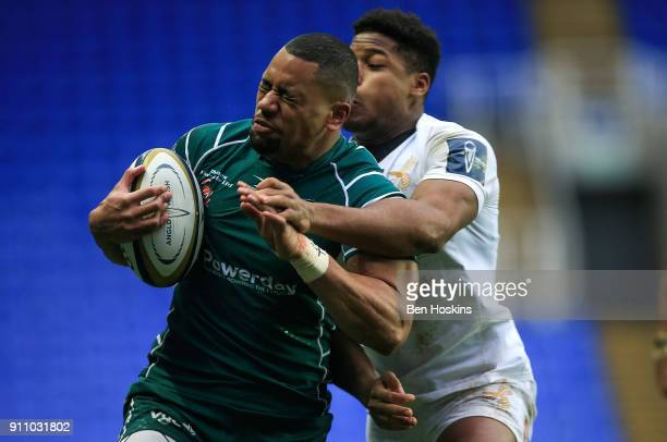 Joe Cokanasiga of London Irish is tackled by Taju Atta of Wasps during the AngloWelsh Cup match between London Irish and Wasps at Madejski Stadium on...