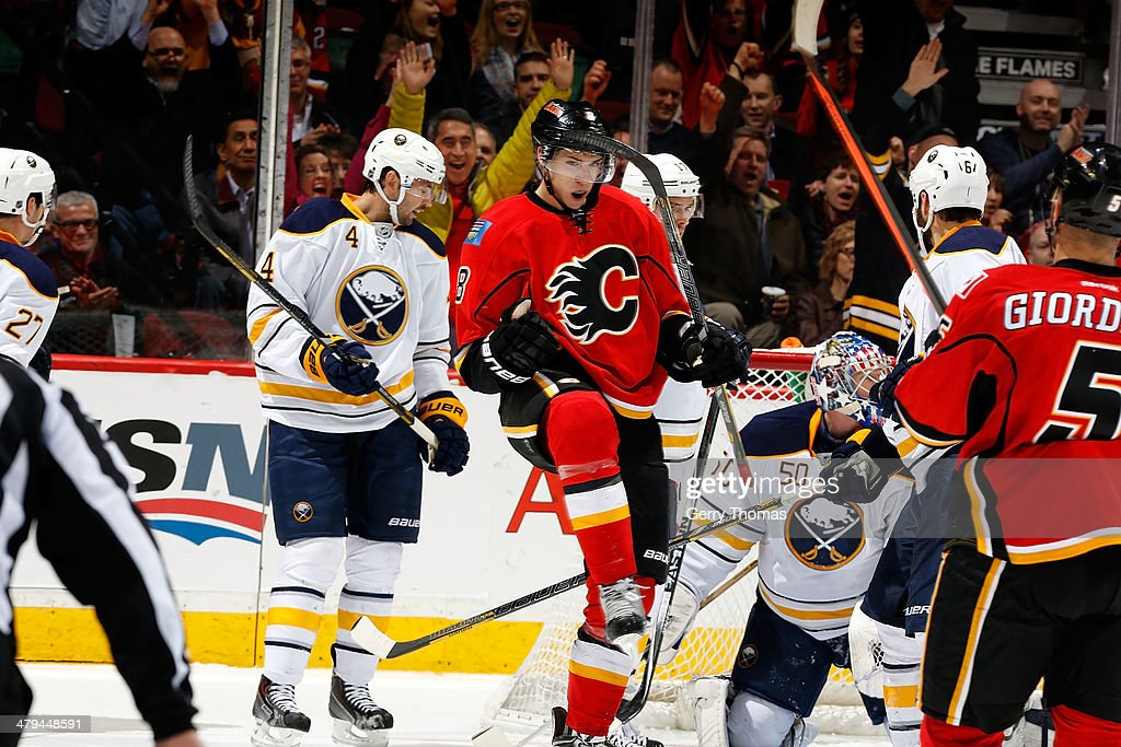 Joe Colborne #8 of the Calgary Flames celebrates a goal against the Buffalo Sabres at Scotiabank Saddledome on March 18, 2014 in Calgary, Alberta, Canada.