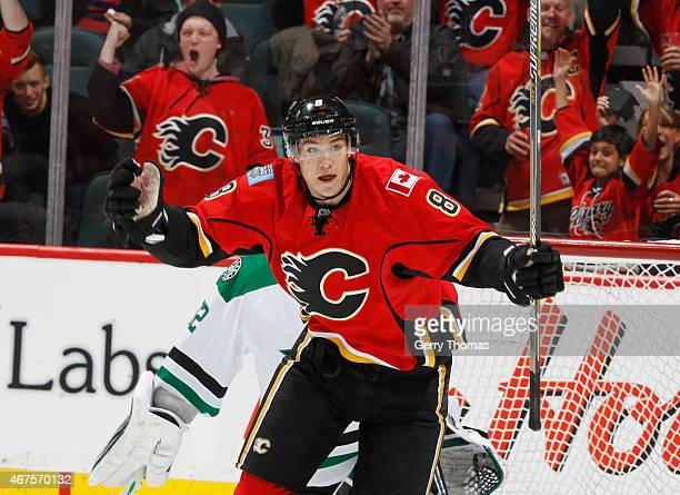 Joe Colborne of the Calgary Flames celebrates after a goal against the Dallas Stars at Scotiabank Saddledome on March 25 2015 in Calgary Alberta...