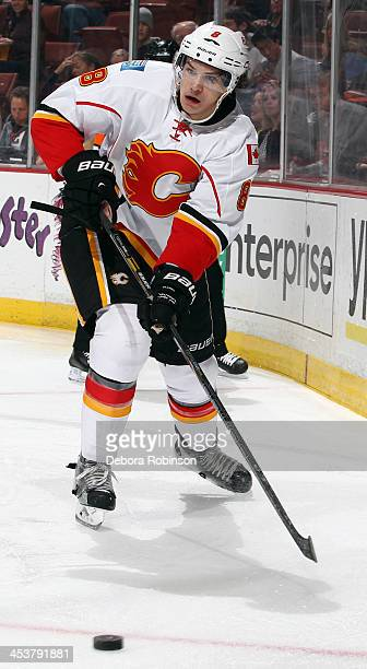 Joe Colborne of the Calgary Flames handles the puck during the game against the Anaheim Ducks on November 29 2013 at Honda Center in Anaheim...