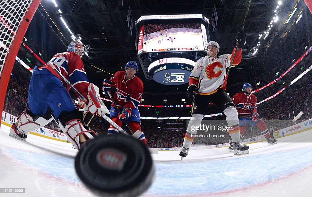 Joe Colborne #8 of the Calgary Flames scores a goal against the Montreal Canadiens in the NHL game at the Bell Centre on March 20, 2016 in Montreal, Quebec, Canada.