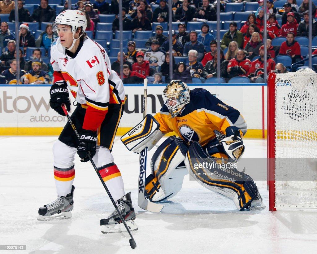 Joe Colborne #8 of the Calgary Flames screens Jhonas Enroth #1 of the Buffalo Sabres at First Niagara Center on December 14, 2013 in Buffalo, New York. Calgary defeated Buffalo 2-1.