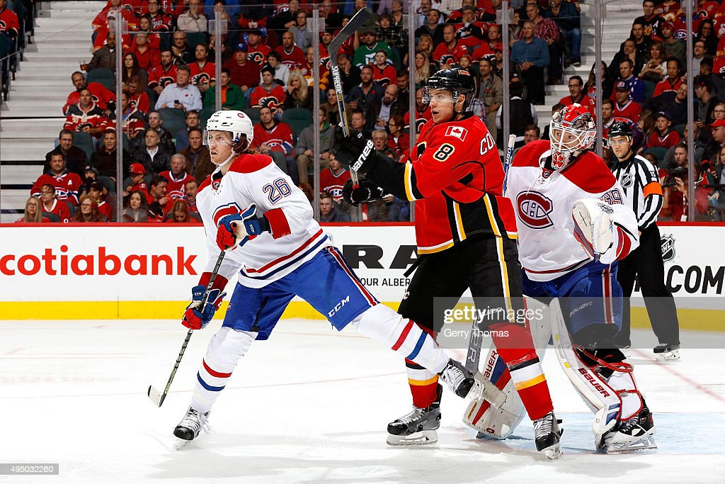 Joe Colborne #8 of the Calgary Flames skates against Jeff Petry #26 of the Montreal Canadiens during an NHL game at Scotiabank Saddledome on October 30, 2015 in Calgary, Alberta, Canada.