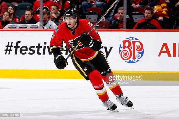 Joe Colborne of the Calgary Flames skates against the Carolina Hurricanes at Scotiabank Saddledome on December 12 2013 in Calgary Alberta Canada...