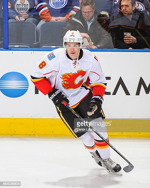 Joe Colborne of the Calgary Flames skates against the Edmonton Oilers during an NHL game at Rexall Place on December 7 2013 in Edmonton Alberta Canada