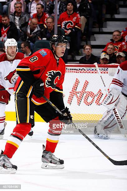 Joe Colborne of the Calgary Flames skates against the Phoenix Coyotes at Scotiabank Saddledome on December 4 2013 in Calgary Alberta Canada Calgary...