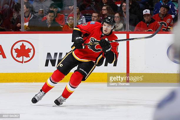 Joe Colborne of the Calgary Flames skates against the Tampa Bay Lightning at Scotiabank Saddledome on January 3 2014 in CalgaryAlberta Canada