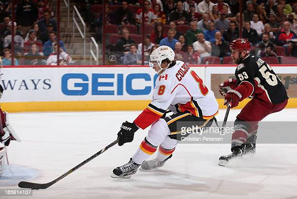 Joe Colborne of the Calgary Flames skates in to score a third period goal past Derek Morris of the Phoenix Coyotes during the NHL game at Jobingcom...