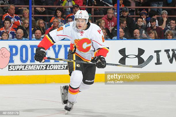 Joe Colborne of the Calgary Flames skates on the ice in a game against the Edmonton Oilers on December 7 2013 at Rexall Place in Edmonton Alberta...