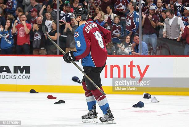Joe Colborne of the Colorado Avalanche celebrates his hat trick against the Dallas Stars with his bench at the Pepsi Center on October 15 2016 in...
