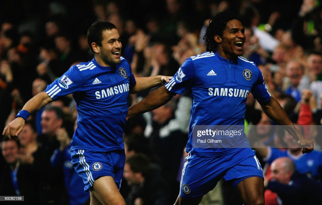 Joe Cole and Florent Malouda of Chelsea celebrates Malouda's goal during the Barclays Premiership match between Chelsea and Wolverhampton Wanderers at Stamford Bridge on November 21, 2009 in London, England.