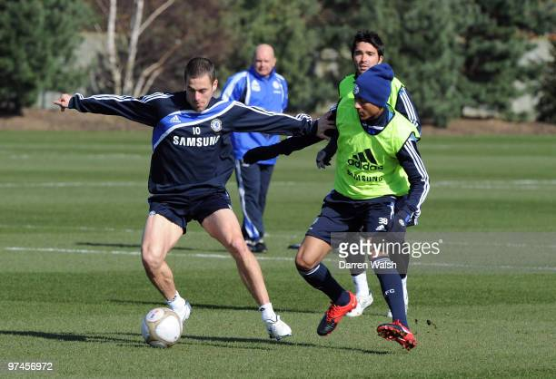 Joe Cole and Patrick Van Aanholt of Chelsea during a training session at the Cobham Training ground on March 5, 2010 in Cobham, England.