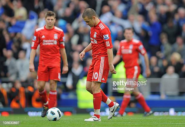 Joe Cole and Steven Gerrard of Liverpool look dejected after the 2nd Everton goal during the Barclays Premier League match between Everton and...