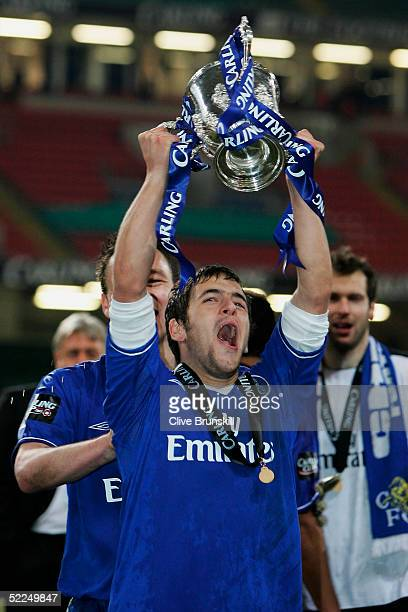Joe Cole celebrates with the Carling Cup trophy at the end of the Carling Cup Final match between Chelsea and Liverpool at the Millennium Stadium on...