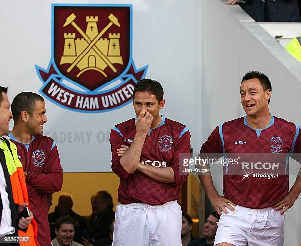 Joe Cole Frank Lampard and John Terry share a joke ahead of their introduction during the Tony Carr Testimonial match between the Academy AllStars...